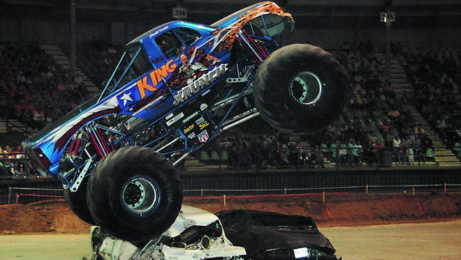 King Krunch rolls over vehicles during a past monster truck show in the Rapides Parish Coliseum. Monster truck shows won't be allowed in the Coliseum once the building reopens, officials say.