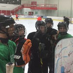 Northville players (from left) Jack Meacham, Kyle Abraham, P.J. Scnepp, Nick Strom and Alec Morgan receive instruction during a recent practice.