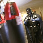 Darth Vader leaves the office Dec. 18, 2015, at his gym, Allegiant Fitness, in Canandaigua, N.Y.  Vader, 43, legally changed his name from Eric Welch.
