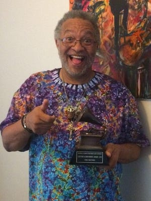 Bass player George Porter reacts to his lifetime Grammy Award for his work with The Meters in the '60s and '70s.