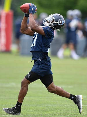 Titans cornerback Malcolm Butler pulls in the ball during practice in June at Saint Thomas Sports Park.