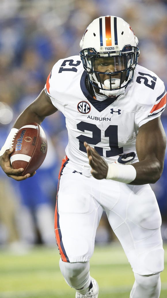 Auburn freshman Kerryon Johnson lined up at tailback, wide receiver and Wildcat quarterback.