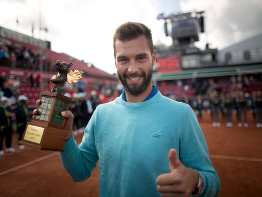 Benoit Paire of France, celebrates his victory against Tommy Robredo, of Spain, after the final of the Skistar Swedish Open tennis tournament in Bastad, Sweden, Sunday, July 26, 2015. (Bjorn Larsson Rosvall / TT via AP) SWEDEN OUT
