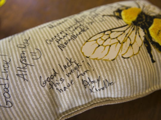 Neil Maes of Belton, S.C., has a pillow with messages of support written on it for him regarding his spelling bee competition.