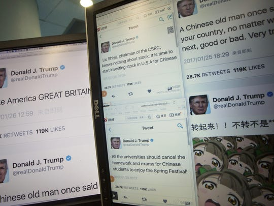 Computer screens display the fake tweets that online users can self generate at a Chinese website in Beijing, China, Jan. 26, 2017. Online users are flocking to a new Chinese website that lets them generate images of fake tweets that look just like those sent by President Donald Trump's distinctive personal Twitter account_ replete with his avatar and a real-time timestamp.
