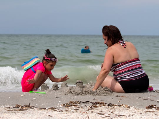 Leah Feliciano, 4, of Union, N.J., plays with her aunt, Diana DeJesus, on Bowman's Beach.