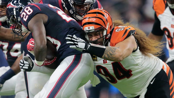 Cincinnati Bengals defensive tackle Domata Peko (94) tackles Houston Texans running back Alfred Blue (28) in the first quarter during the Week 16 NFL game between the Houston Texans and the Cincinnati Bengals, Saturday, Dec. 24, 2016, at NRG Stadium in Houston, Texas. The Cincinnati Bengals lead 3-0 at halftime.