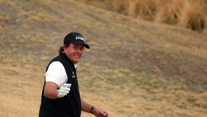 Phil Mickelson smiles and wave to fans after teeing off on 1on the Nicklaus Tournament Course during the 2nd round of the CareerBuilder Challenge on Friday, January 22, 2016. He finished the day tied for 8th place with 11 under.