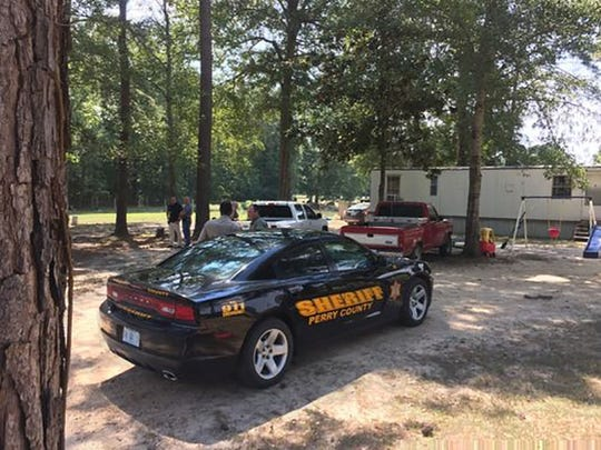 Perry County Sheriff's Department officials are on the scene where a vehicle matching the description of the one used in a shooting incident outside Camp Shelby Tuesday.
