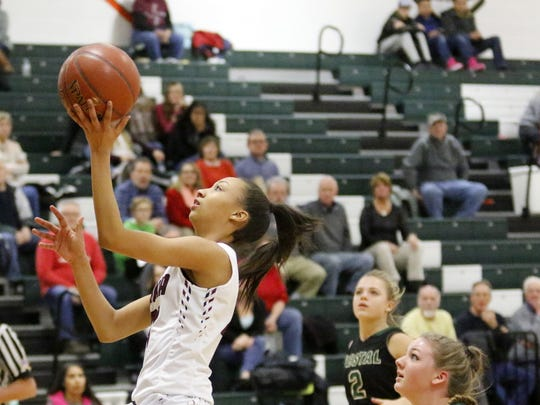 Zaria Thomas goes in for a layup against Vestal earlier this season. She leads Elmira in scoring at 19.2 points per game.