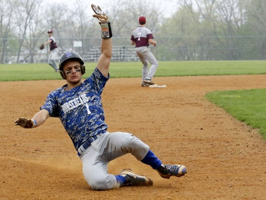Nico Limoncelli of Horseheads slides safely into third Saturday during the Blue Raiders' 12-0 win over Elmira at Ernie Davis Academy.