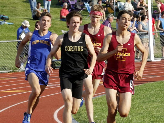 Corning's Kevin Moshier, front left, runs on his way to a win in the boys 1,600 meters Thursday at the STAC championship meet at Windsor High School. Maine-Endwell's Matt Goyden, back left, placed second, with Ithaca's Silas Derfel, front right, and Noah Sorensen taking third and fourth.
