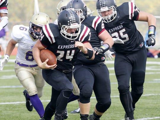 Elmira's Charlie Mahon runs for a touchdown Saturday