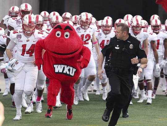 Western Kentucky's mascot Big Red leads the Hilltoppers
