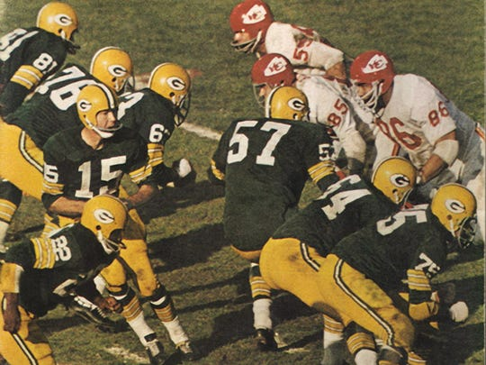 Bart Starr, behind a stout offensive line, hooked up with Max McGee for two touchdowns in the rout of the Chiefs.