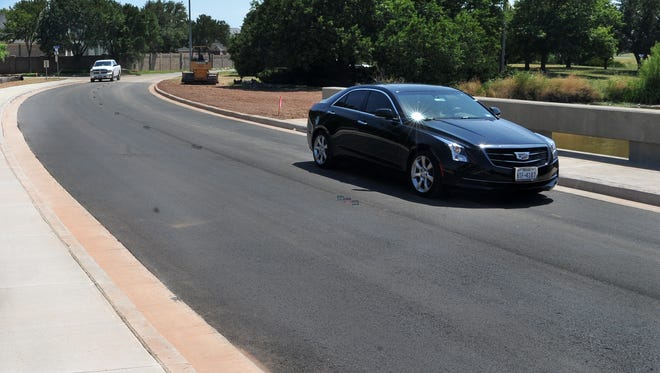 Traffic travels smoothly down northbound Maplewood Ave., Tuesday afternoon after TxDOT contractors finished the construction project that replaced the culverts along both north and southbound lanes.