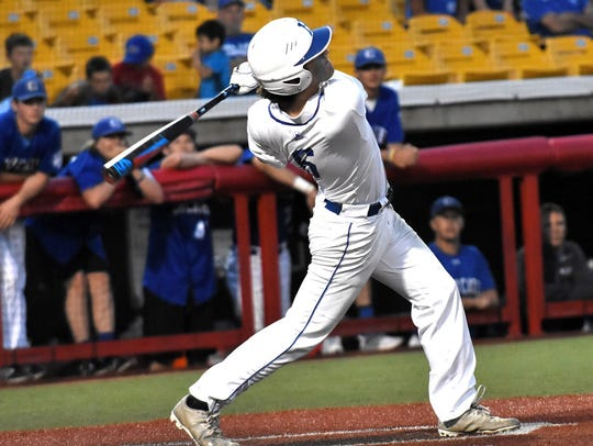 Ethan Kavanaugh (6) drives a triple off the wall to