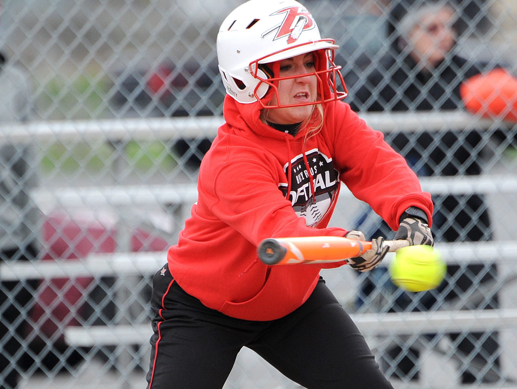 Bucyrus' Izzy Burling bunts the ball Wednesday evening during their game against Upper Sandusky.