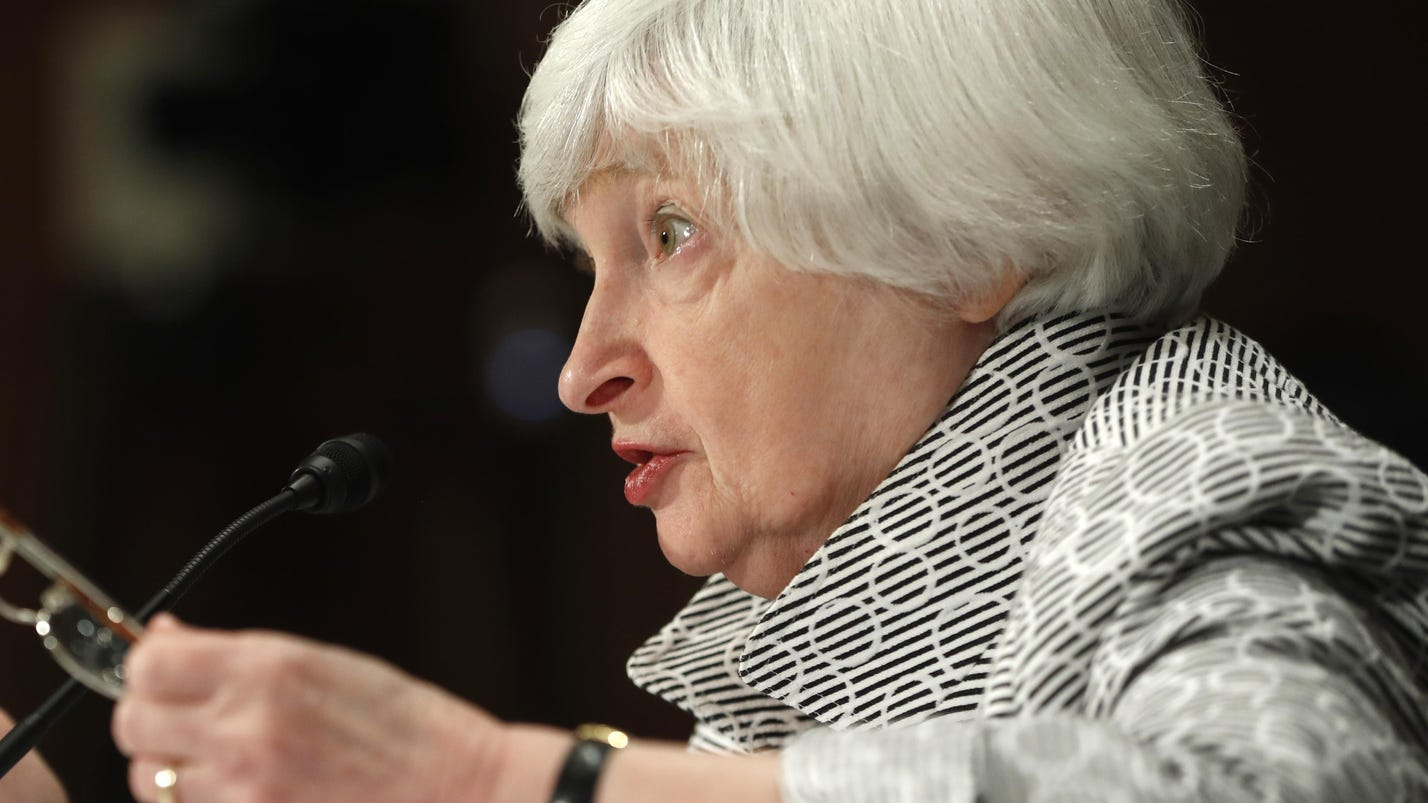 Fed to start modestly reducing its bond holdings