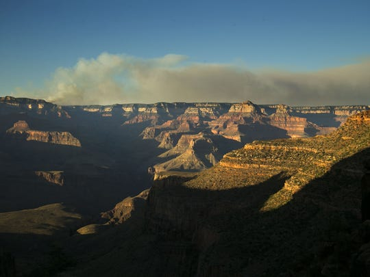 The Fuller Fire burns on the North Rim of the Grand Canyon as seen from the Bright Angel Trail below the South Rim in Grand Canyon National Park on Thursday, July 14, 2016.