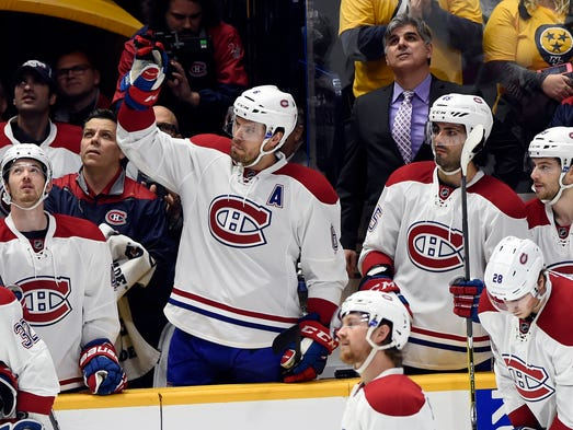 Montreal Canadiens' Shea Weber, center, acknowledges