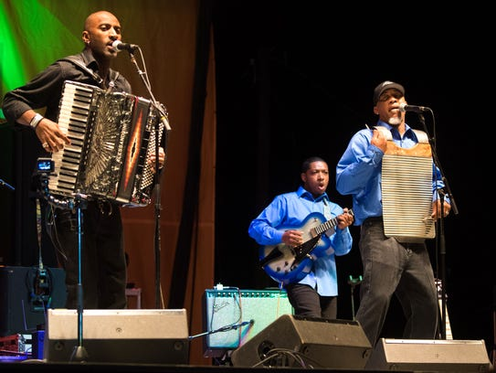 Curley Taylor at Zydeco Trouble entertain at noon June