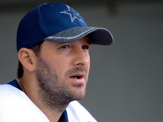 FILE - In this Aug. 1, 2016, file photo, Dallas Cowboys quarterback Tony Romo takes to reporters at the end of practice in Oxnard, Calif.  Two people with knowledge of the plan say Romo will be an honorary Dallas Mavericks player for their home finale, wearing his football No. 9 while sitting on the bench. Romo can be added to the Mavericks' roster for a day because of an open spot, one of the people told The Associated Press on Saturday, April 8, 2017.  (AP Photo/Gus Ruelas, File)