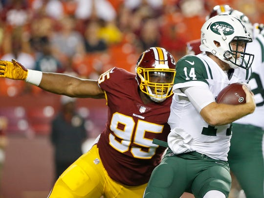 Aug 16, 2018; Landover, MD, USA; Washington Redskins defensive tackle Da'Ron Payne (95) sacks New York Jets quarterback Sam Darnold (14) in the first quarter at FedEx Field. Mandatory Credit: Geoff Burke-USA TODAY Sports