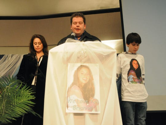 In this 2008 photo Bridgette Denison, left, and Brighton Denison, 15, right, participate in a prayer for Brianna Denison, who went missing on Jan. 20, 2008
