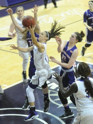 ACU's Sara Williamson drives for a shot against the Northwestern State defense.  The Wildcats beat Northwestern State 79-57 in a Southland Conference game Saturday, Feb. 11, 2017 at Moody Coliseum.