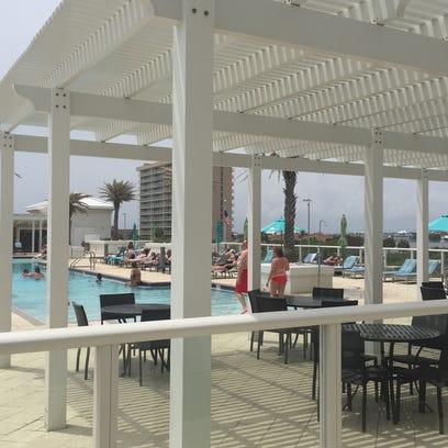 Vacationers enjoy the Margaritaville Beach Hotel  beach-side
