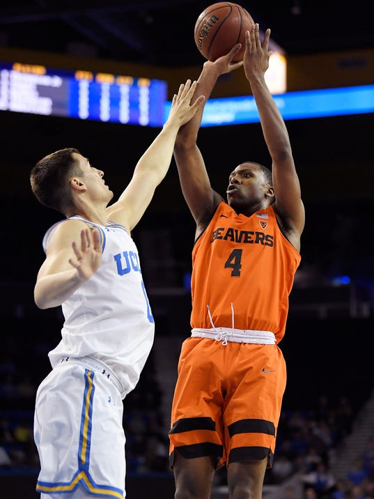 Oregon State forward Alfred Hollins, right, shoots as UCLA forward Alex Olesinski defends during the first half of an NCAA college basketball game Thursday, Feb. 15, 2018, in Los Angeles. (AP Photo/Mark J. Terrill)