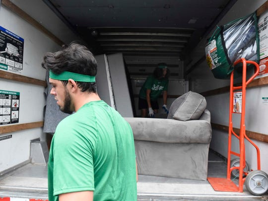 Brock Ivey-Bodman of Bellhops, an on-demand moving company that employs college students, moves a customer July 28, 2016, in Nashville.