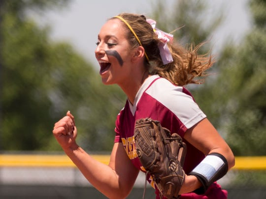Cassie Smith celebrates a late game strikeout she threw as Scecina Memorial High School beat Elwood High School 6-2 for the 2A state softball title, from Ben Davis High School, Indianapolis, Saturday, June 10, 2017.