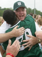 Tower Hill athletic director Jack Holloway hugs goalie Demetrius Murray after Tower Hill's 5-4 double overtime win against Salesianum in the 2010 state championship lacrosse game.