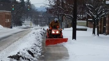 The city of Asheville has two tractors equipped with plows and salt spreaders, and four walk-behind snow blowers for snow removal on city sidewalks.
