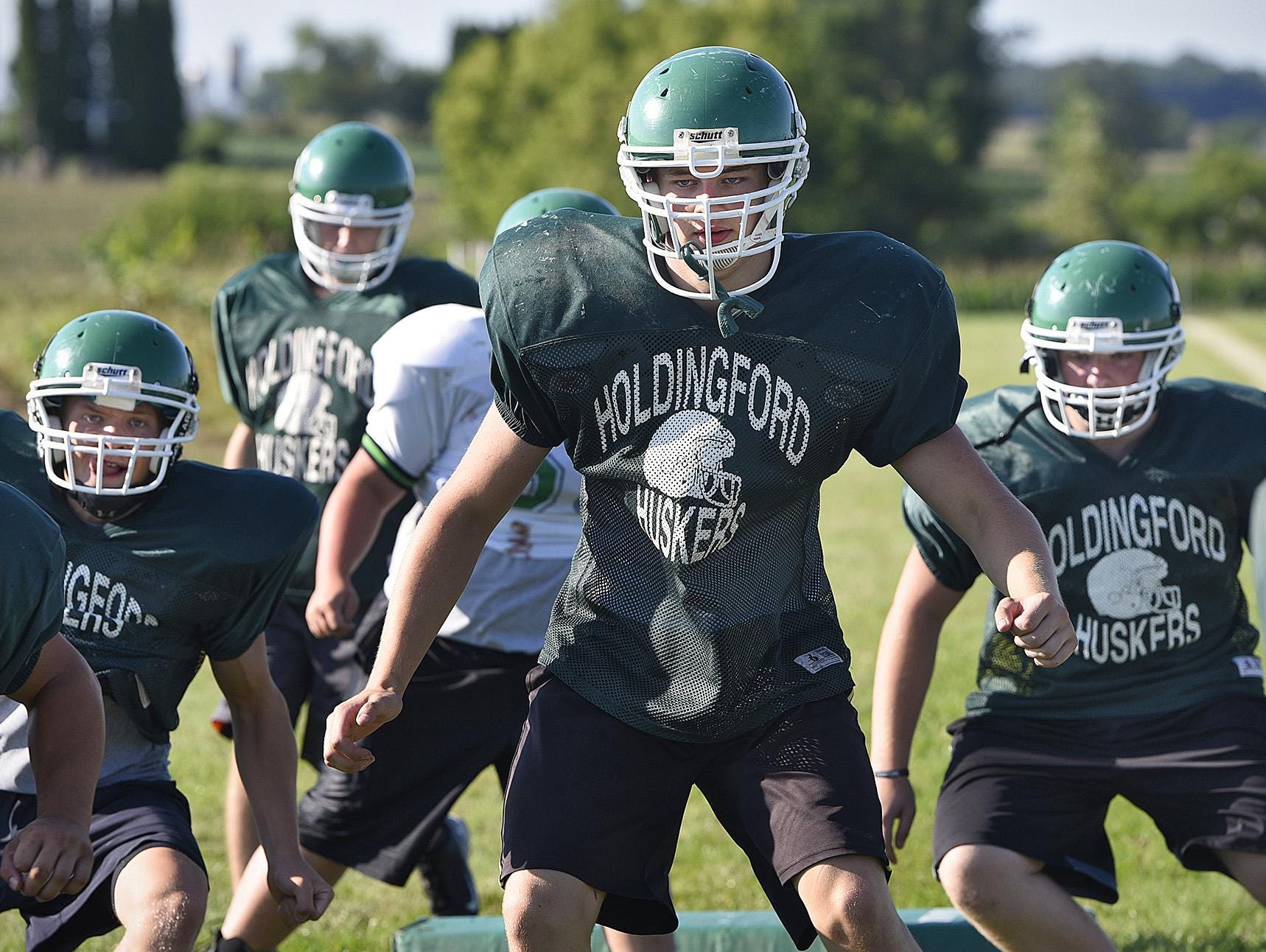 Holdingford players complete a drill during practice Wednesday in Holdingford.
