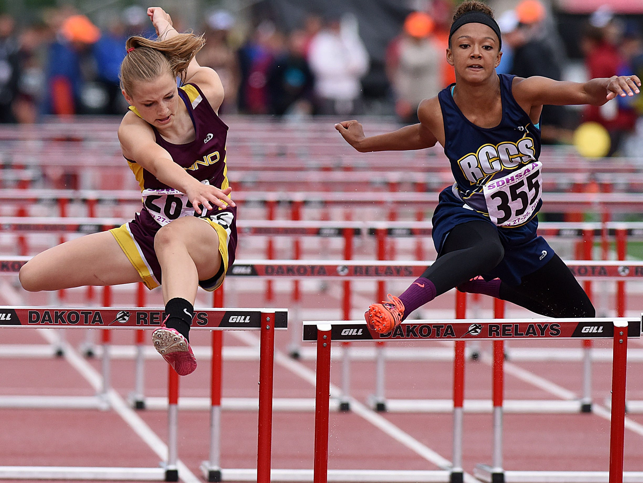 Menno's Ashton Vaith and Rapid City Christian's Audrey Truitt o cross the finish line in the Class B girls 100-meter hurdles during the 2016 SD State Track and Field Meet at Howard Wood Field on Saturday, May 28, 2016.