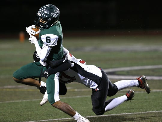 Past Fields (6) of Long Branch is tackled by Chance Benjamin (33) of Jackson Memorial after a catch during  NJSIAA Central Group IV semifinal high school football game at Long Branch High School, Long Branch,NJ. Friday, November 17, 2017. Noah K. Murray-Correspondent Asbury Park Press