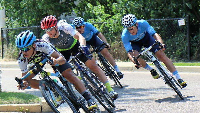 These pro cyclists rounded a curve of the .6 mile loop around The Lift during the Criterium Races of the 2018 Rockabilly Gran Prix that was held in Jackson on Sunday, June 10, 2018.