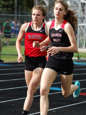 Brandon Valley's Courtney Klatt (right) runs against Yankton's Savannah Woods in the 1600-meter run.
