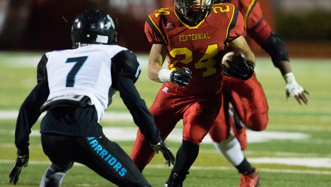 Santa Teresa's Samuel Martinez (No. 7) takes aim on Centennial ball carrier Joaquin Gutierrez during Thursday's high school football game at the Field of Dreams.