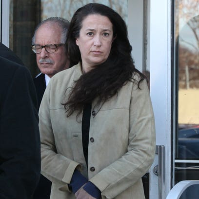 Emily Dearden, an NYPD psychologist, leaves courthouse