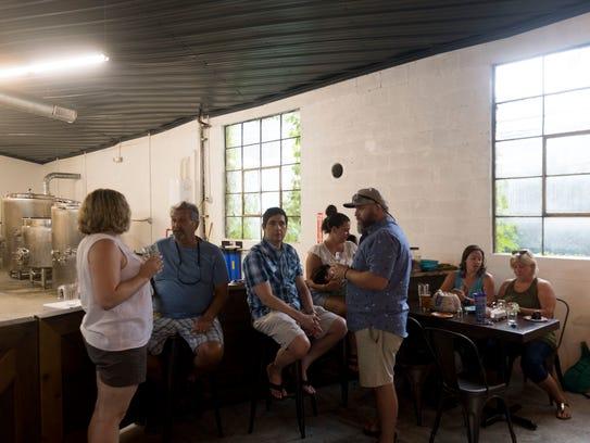 Guests gather for drinks at Printshop Beer Co. on Sunday,