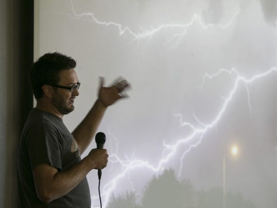 Storm chaser Mike Olbinski speaks at Saturday's ChaserCon in Chandler. Valley weather chasers gathered to network and share their mass ion for Arizona's monsoon season.