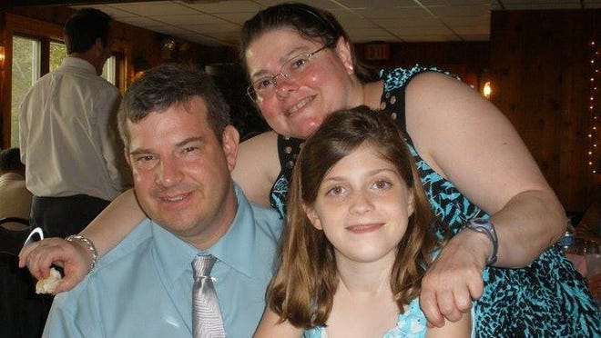 The Smith-Welk Family, clockwise, Gary Smith, Lisa Welk and their daughter Shawna Smith.