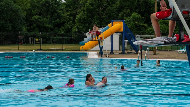 Emily Day (right to left) leads the way as her nieces Hannah Pastore, 10, and Gabby Pastore, 6, and her daughter Kiera Day, 8, swim across the Newburgh Pool in Newburgh, Ind., on Sunday, June 18, 2017. Their family invited loved ones to join them at the pool to celebrate Pastore's sixth birthday on Sunday, which coincided with the pool's 45th anniversary.
