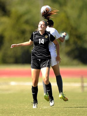 Thomas Metthe/Reporter-News Hardin-Simmons' Sarah Krisa (14) goes up for a header with a Sul Ross defender during the Cowgirls' 8-1 win on Saturday, Oct. 22, 2016, at the HSU Soccer Complex.