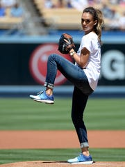 LOS ANGELES, CA - AUGUST 17:  Jessica Alba throws out the ceremonial first pitch before the game between the Milwaukee Brewers and the Los Angeles Dodgers at Dodger Stadium on August 17, 2014 in Los Angeles, California.  (Photo by Harry How/Getty Images)