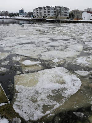 Plates of ice float out to Lake Michigan on the Sheboygan River on Jan. 7, 2015 in Sheboygan.